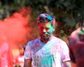 "A participant under blast of colors during celebration of Holi in India. Holi is a Hindu spring festival celebrated in India and Nepal, also known as the ""festival of colours"" or the ""festival of love"". - Wikipedia"