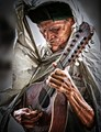 Old Musician, Ancient Guitar