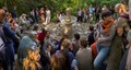 group of friends gather around the fountain at Casa Giorgi Park, near Milano, Italy.