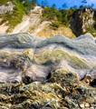 Seashells rocks and cliffs