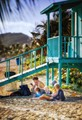 Paradise like island off the coast of Puerto Rico. A mother reads a book. Memories the children will never forget.