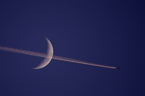 Jet trail across moon