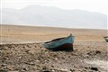 Fishing boat in Peru Desert