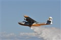 PBY Water bomber drops its load