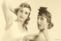 Two girls dressed like in the twenties.