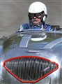 Matching moustaches - Driver and Austin Healey automobile in England