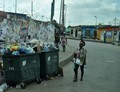 Against the backdrop of the typical colourful buildings, garbage alongside a street in Luanda is awaiting collection.
