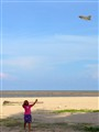 girl plays kite
