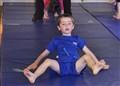 Working hard in Gymnastics class