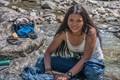 Nepali Girl's smile while Laundering