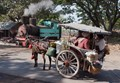 Horse drawn taxi waits for a passing steam engine, Pagottan Sugar Mill, Java