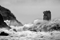 Storms batter the coast near Dingle, Ireland but the sea stack An Searrach Stands firm.