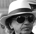 Serious man in a white hat and black sunglasses