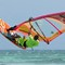 Ethan Westera doing a Ethan Westera WOW windsurfing trick at Hi-Winds Aruba