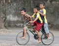 Three Friends on a Bike