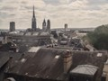 The tower is the only thing left of the Rouen castle built in 1204. This is the view from the tower. The distortion in the glass makes an interesting effect.