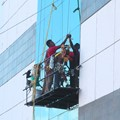 Window washer working in Cancun Mexico