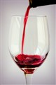 Pouring Glass of Red