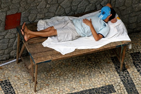 Nap on the sidewalk