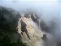 Windy Stormy weather - Barron Falls already in flood with more rain blowing up from the gorge below