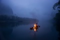 Fisherman in the foggy morning
