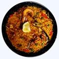 Paella - is a Spanish rice dish originally from Valencia. Paella de marisco -  Seafood Paella.