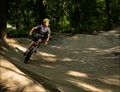 A through-the-woods bike trail full of jumps and banked turns.