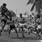 Soccer Pakistan: Players from KMC (Karachi Municipal Corporation) and KPT (Karachi Port Trust)  struggle during their match of the Kohati Memorial Football (soccer) Tournament at KMC stadium in Karachi May4, 1975. Photo: Zahid Hussein