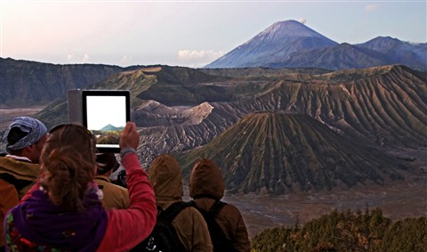 Woman with tablet at Mt Bromo