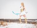 K8ie cosplays Freljord Ashe in the snow
