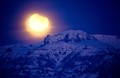 The end of the Partial Lunar Eclipse of April 15th, 1995, as the moon sets behind The Citadel mountain, southwest of Cody, Wyoming, USA, shortly before local dawn.  Taken back in the days of slide film!