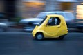 Very cute little car seen in Florence, Italy.  It's a three-wheeled electric  vehicle.