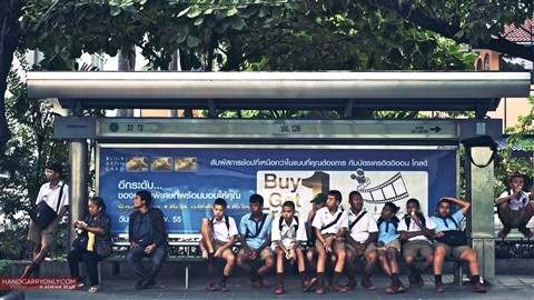 Kids waiting at the bus stop