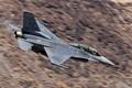 An Edwards AFB F-16 makes a run through Rainbow Canyon. 25 Mar. 2019