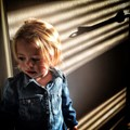 My grandaughter plaiyin in the shadows