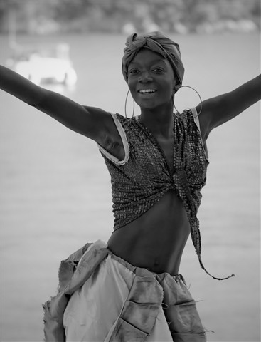 A dancer today in Haiti, snapped with the Ricoh GXR and Leica 90mm f-2.8 lens