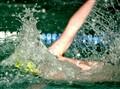 Swimmer creating a splash