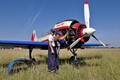 Basic trainer aircraft of the Romanian Air Force, the Yakovlev Yak-52, being serviced on the grass at Boboc airfield.