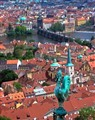 The view of Charles Bridge out of an arrow slit from Prague Castle